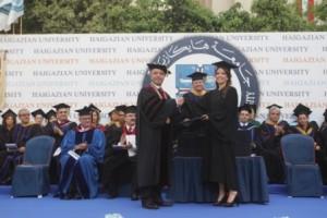 Valedictorian Lori Agopian receiving her degree