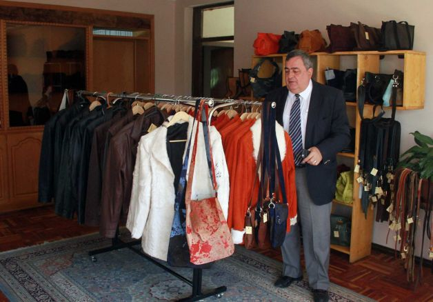 64 year old Ethiopian-Armenian leather businessman Vartkes Nalbandian look at the items in his shop in Addis Ababa, Ethiopia. Vartkes is among a small handful of people keeping the Armenian community in Ethiopia alive.  Photo: Elias Asmare, AP